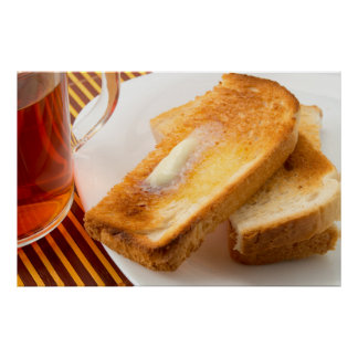 Hot toast with butter on a white plate close-up poster