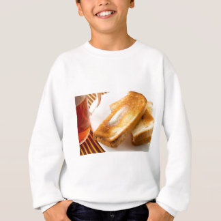 Hot toast with butter on a white plate close-up sweatshirt