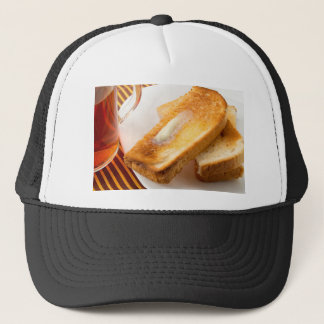 Hot toast with butter on a white plate close-up trucker hat