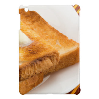 Hot toast with butter on a white plate iPad mini cover