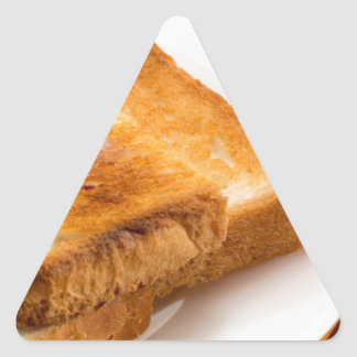 Hot toast with butter on a white plate triangle sticker