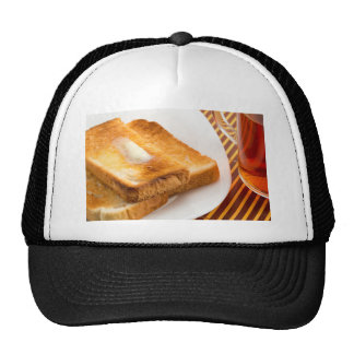 Hot toast with butter on a white plate trucker hat