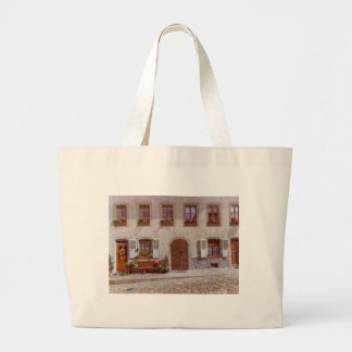 House in Gruyere village, Switzerland Large Tote Bag