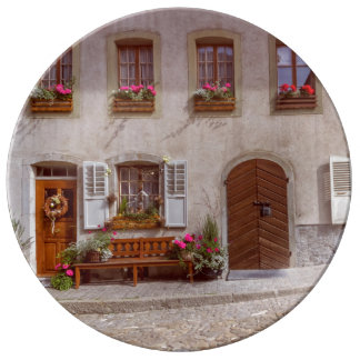 House in Gruyere village, Switzerland Plate