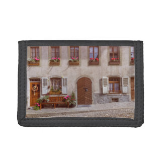 House in Gruyere village, Switzerland Tri-fold Wallet