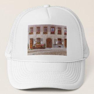 House in Gruyere village, Switzerland Trucker Hat