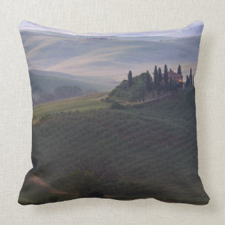 House in Tuscany in the morning fog throw pillow