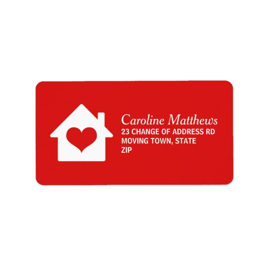 House with heart on red background label