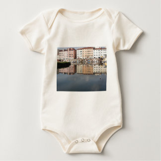 Houses and boats are reflected in the water baby bodysuit