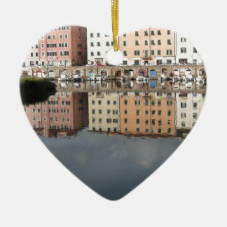 Houses and boats are reflected in the water ceramic ornament