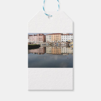 Houses and boats are reflected in the water gift tags