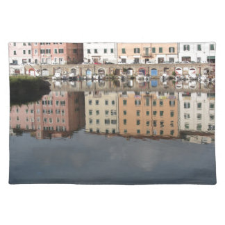 Houses and boats are reflected in the water placemat