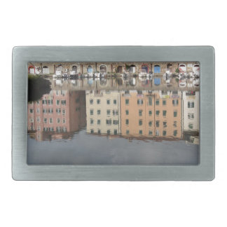 Houses and boats are reflected in the water rectangular belt buckle