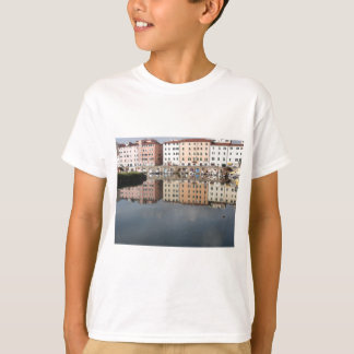 Houses and boats are reflected in the water T-Shirt