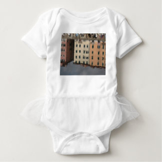 Houses are reflected in the tranquil water baby bodysuit