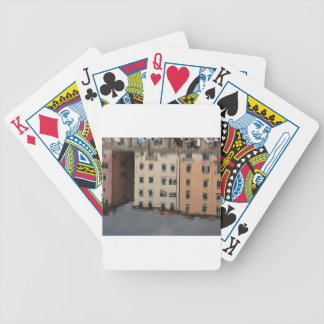 Houses are reflected in the tranquil water bicycle playing cards