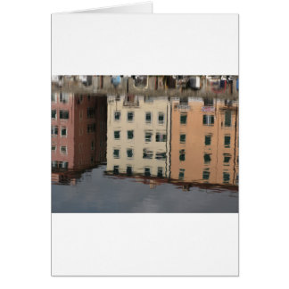 Houses are reflected in the tranquil water card