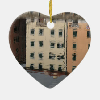Houses are reflected in the tranquil water ceramic heart ornament