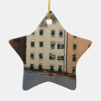 Houses are reflected in the tranquil water ceramic star ornament