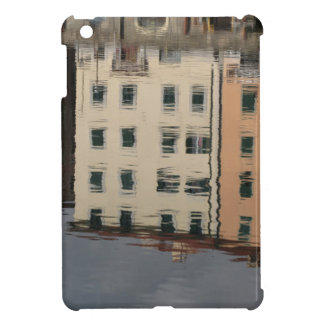 Houses are reflected in the tranquil water iPad mini cases