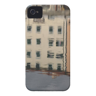 Houses are reflected in the tranquil water iPhone 4 cover