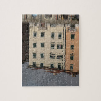 Houses are reflected in the tranquil water jigsaw puzzle