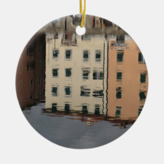 Houses are reflected in the tranquil water round ceramic ornament