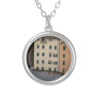 Houses are reflected in the tranquil water silver plated necklace