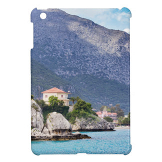 Houses rocks and mountain at greek sea cover for the iPad mini