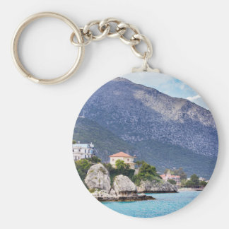 Houses rocks and mountain at greek sea keychain