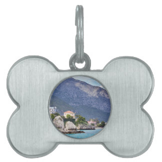 Houses rocks and mountain at greek sea pet tags