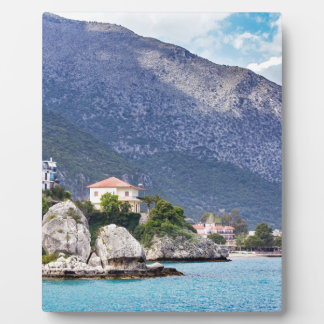 Houses rocks and mountain at greek sea plaque