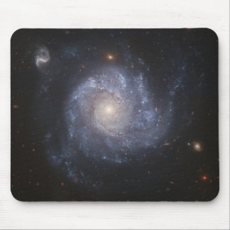 Hubble Snaps Images of a Pinwheel-Shaped Galaxy Mouse Pad