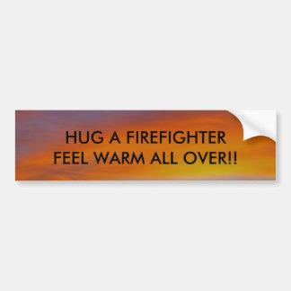 HUG A FIREFIGHTER, FEEL WARM... BUMPER STICKER
