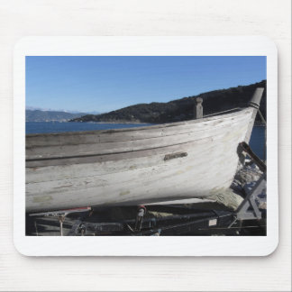 Hull of wooden fishing boat under repair mouse pad
