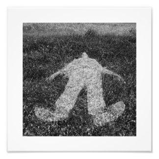 human figure outline imprinted on grass photo print