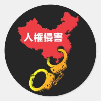 Human rights violations classic round sticker