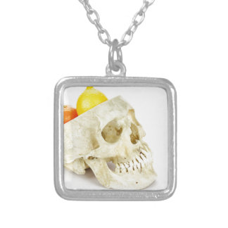 Human skull as fruit scale silver plated necklace