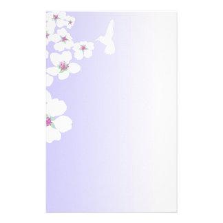 Hummingbird and blossom on purple stationery