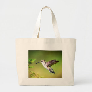 Hummingbird in flight large tote bag