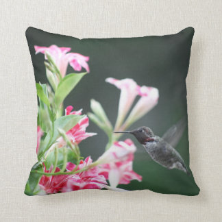Hummingbird in red and white flowers throw pillow