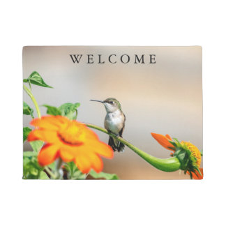 Hummingbird on a flowering plant doormat