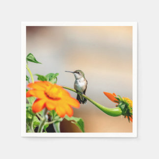 Hummingbird on a flowering plant paper napkin