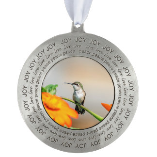 Hummingbird on a flowering plant pewter ornament