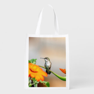 Hummingbird on a flowering plant reusable grocery bag
