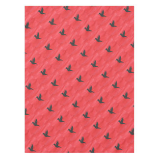 Hummingbird On Red Tablecloth