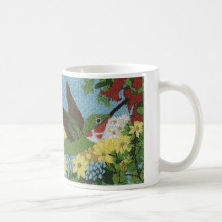Hummingbird reproduced from a hand embroidery coffee mug