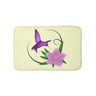 Hummingbird with pink flower bath mat