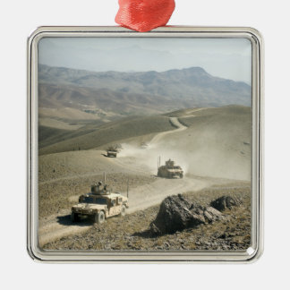 Humvees traverse rugged mountain roads metal ornament