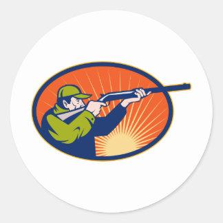 Hunter aiming rifle shotgun side view classic round sticker